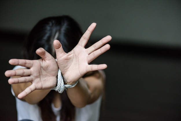 Woman hand were tied with a rope. stop violence