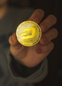Woman hand with dash crypto coin, cryptocurrency exchange and investemnt concept photo