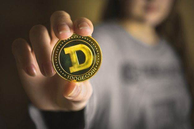 Woman hand with dogecoin, cryptocurrency business background photo