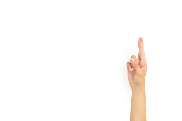 Woman hand with fingers crossed on a white background with copy space