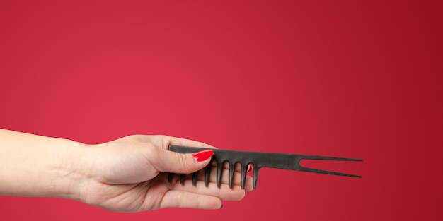 Woman hand with a hair dresser's tools and accessories isolated