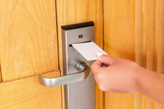 Woman hand with keycard in the electronic lock