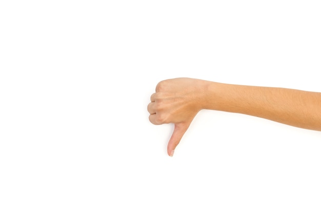 Woman hand with thumb down on a white background with copy space