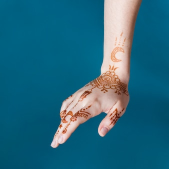 Woman hand with wonderful mehndi draws