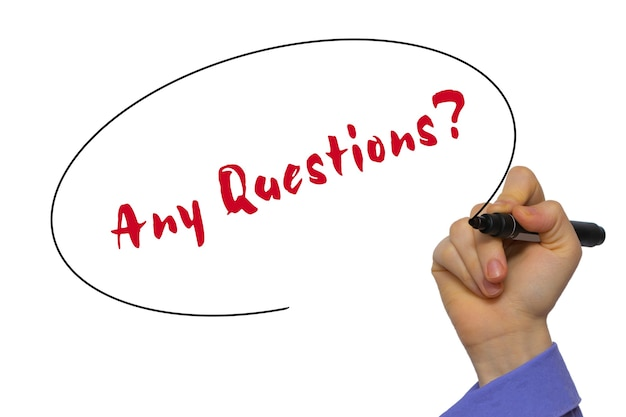 Woman hand writing any questions? on blank transparent board with a marker isolated over white background. business concept. stock photo