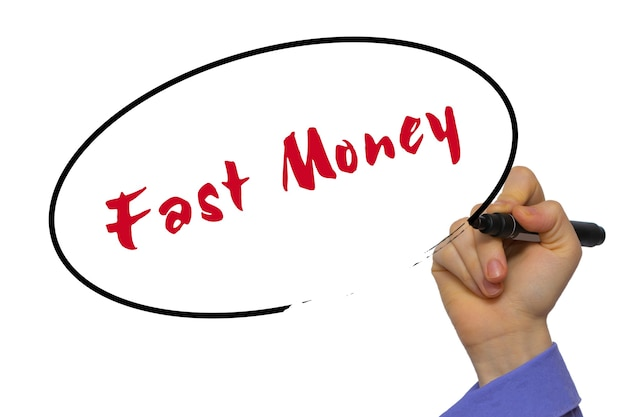 Woman hand writing fast money on blank transparent board with a marker isolated over white background. business concept. stock photo