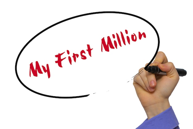 Woman hand writing my first million on blank transparent board with a marker isolated over white background. business concept. stock photo
