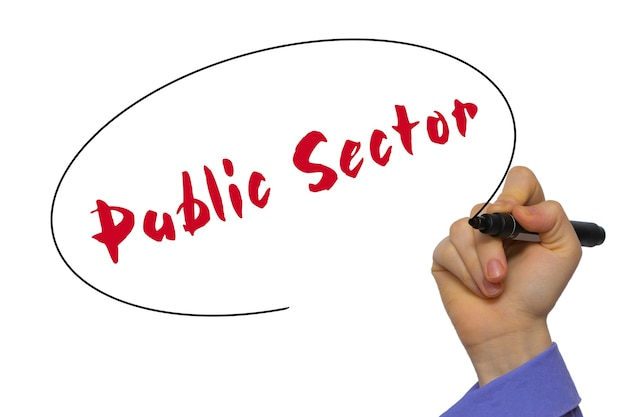 Woman hand writing public sector on blank transparent board with a marker isolated over white background. business concept. stock photo