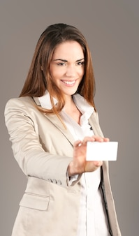 Woman handing a blank business card in studio