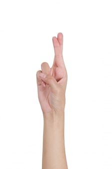 Woman hands gesturing crossed fingers sign by front side isolated on white