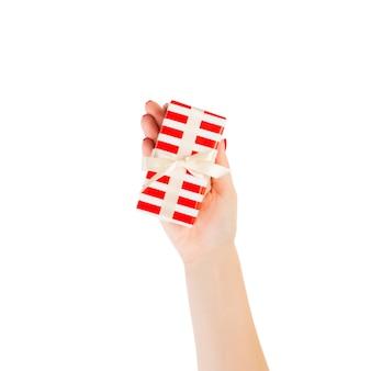 Woman hands give christmas  handmade present isolated