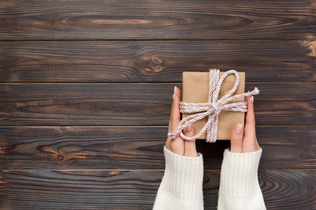 Woman hands give handmade present