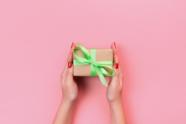 Woman hands give present box