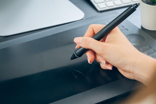 Woman hands graphic designer working on digital tablet