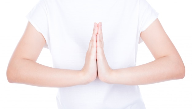 Woman hands greeting  over body isolated on background.