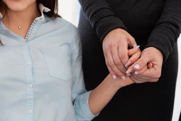 Woman hands holding female patient hand