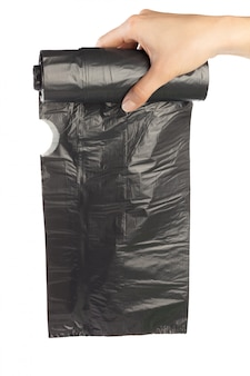 Woman hands holding garbage bag isolated on white