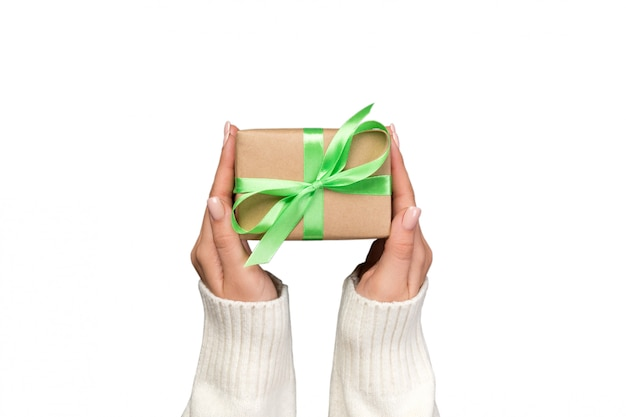 Woman hands holding gift wrapped and decorated