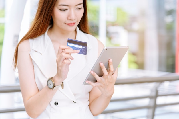 Woman hands online shopping website on laptop easy ecommerce website shop by smartphone