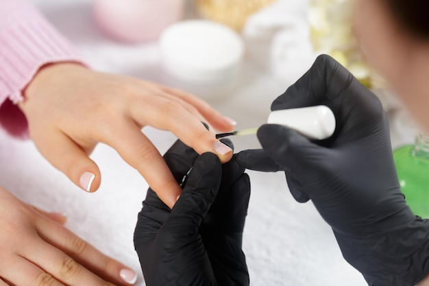 Woman hands receiving a manicure in beauty salon