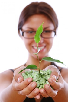 Woman hands taking green plant