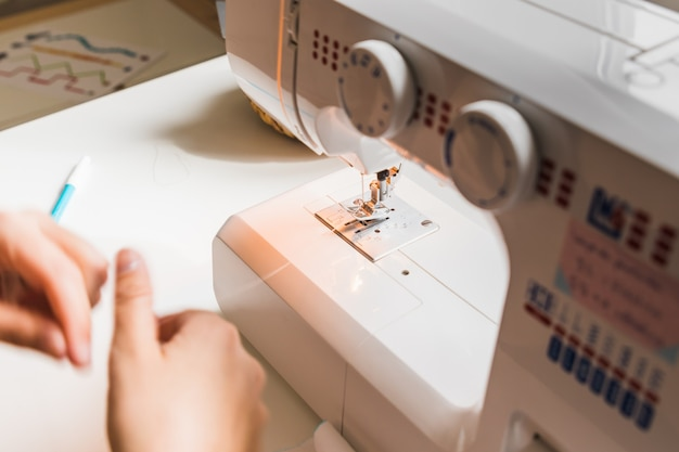 A woman hands using sewing machine