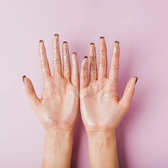 Woman hands with silver glitter top view