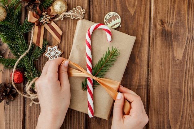 Woman hands wrapping christmas gift