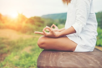 Woman hands yoga meditations and making a zen symbol with her ha