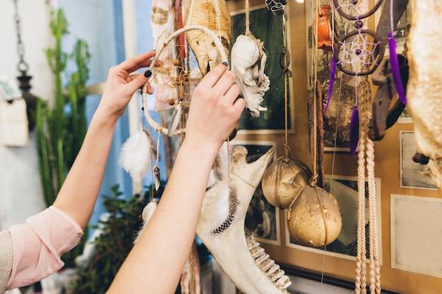 Woman hanging new dreamcatcher in studio