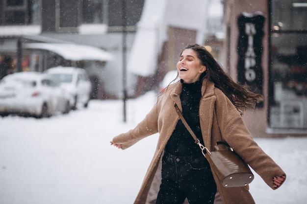 Woman happy in coat in winter outside
