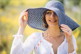 Woman happy in hat