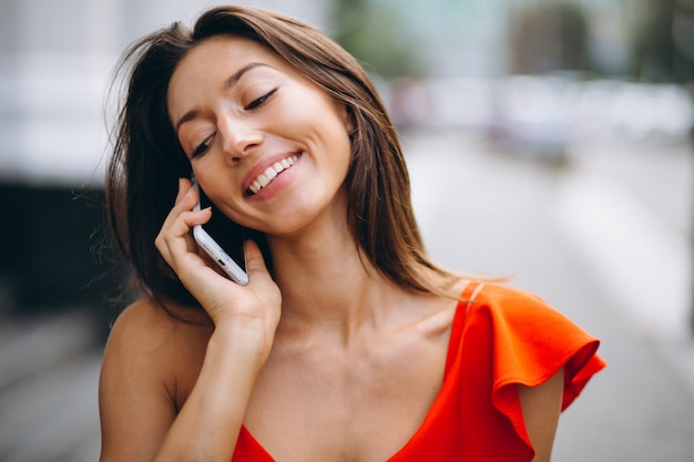 Woman happy on the phone