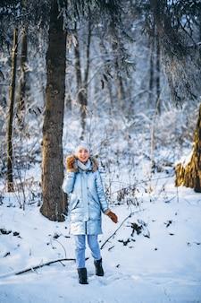Woman happy walking in a winter park