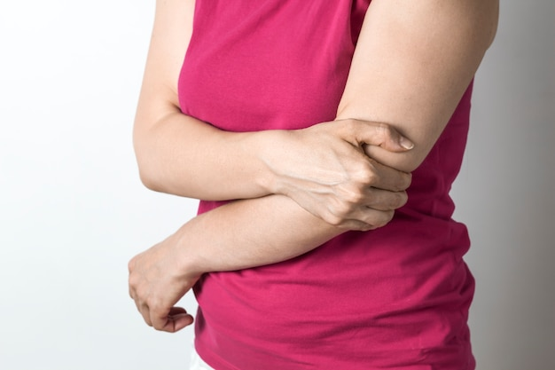 A woman has an elbow pain.