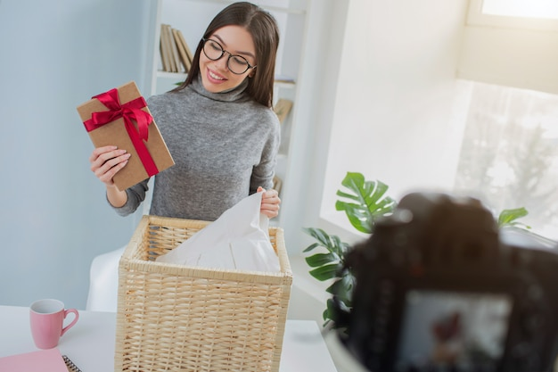 Woman has found a present in the basket with laundry
