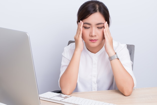 Woman has head pain from work