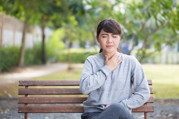 Woman has sore throat at park