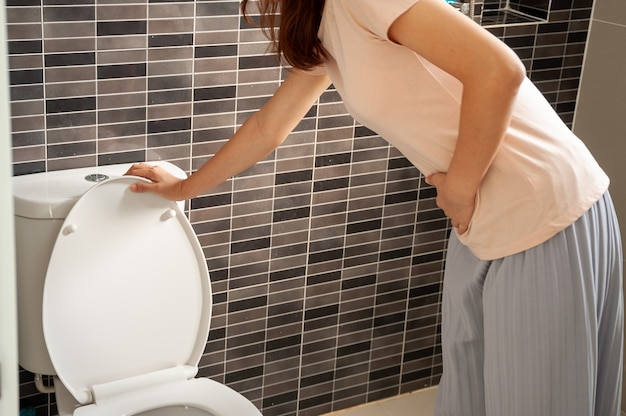 The woman has a stomachache. pregnant people who have diarrhea in the first trimester