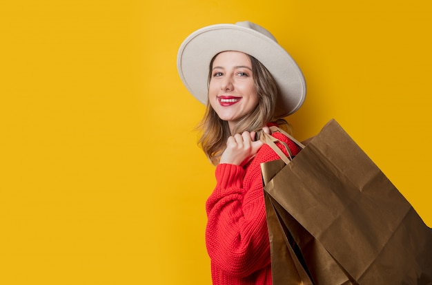 Woman in hat and shopping bags