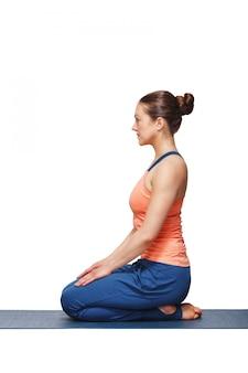 Woman in hatha yoga asana vajrasana