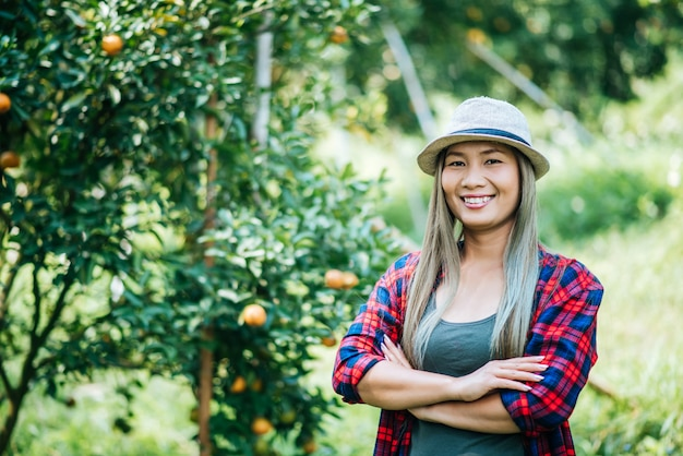 Woman havesting orange plantation
