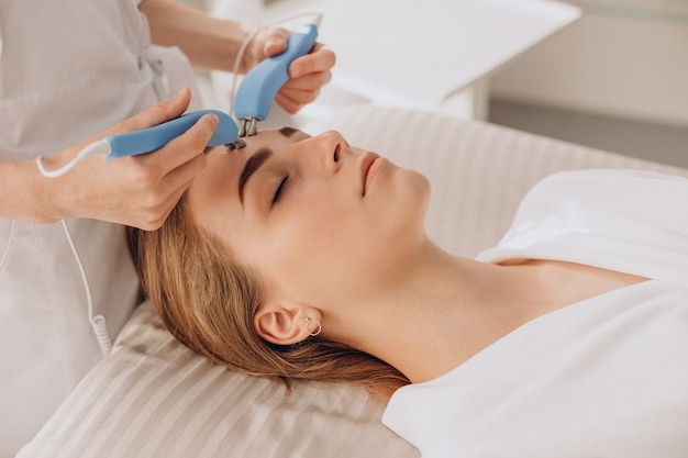 Woman having beauty treatment procedures in a salon