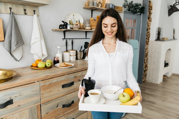 Woman having breakfast at the kitchen