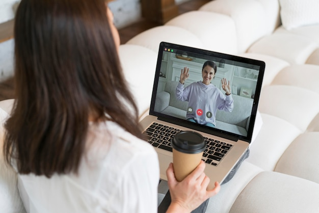 Woman having a business meeting online on her laptop