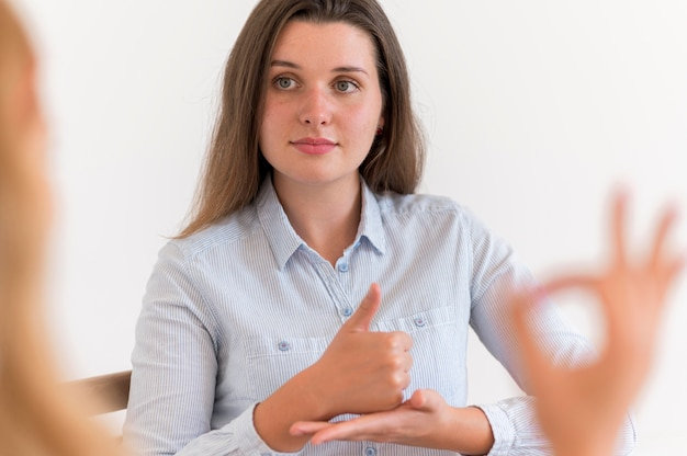 Woman having a conversation with someone using sign language