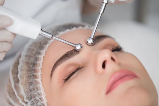 Woman having cosmetic galvanic beauty treatment