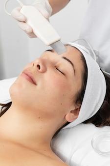 Woman having a facial skincare treatment