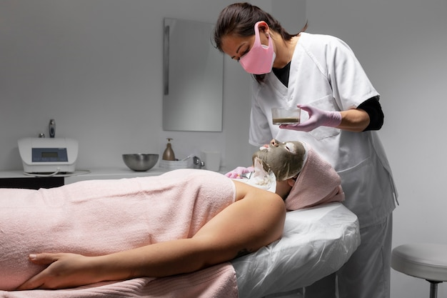 Woman having a facial treatment at the beauty salon