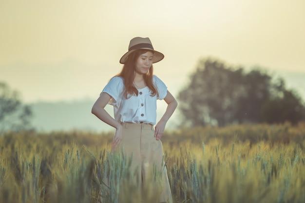 Woman having fun at barley field in summer